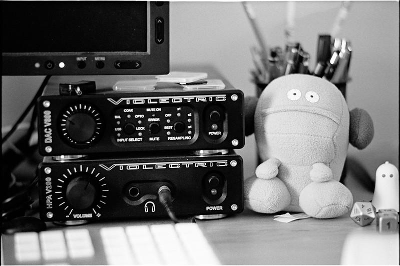 Todd the monster listening to headphones.